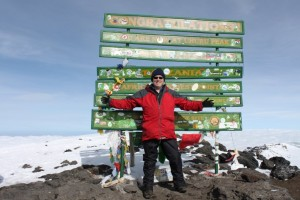 Dr Mike Hughes at the top of Mount Kilimanjaro February 2014